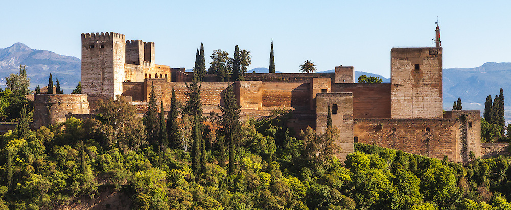 A panorama of the Alhabmra in Granada, Spain. It was constructed during the mid 14th century by the Moorish rulers of the Emirate of Granada in al-Andalus, occupying the top of the hill of the Assabica on the southeastern border of the city of Granada.