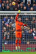 Tottenham Hotspur goalkeeper Hugo Lloris (1) tips a header from Leicester City defender Jonny Evans (6) (not in picture) over the bar  during the Premier League match between Tottenham Hotspur and Leicester City at Wembley Stadium, London, England on 10 February 2019.