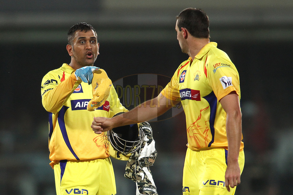 MS Dhoni captain of The Chennai Super Kings talks tactics with Ben Hilfenhaus of The Chennai Super Kings during match 26 of the Pepsi Indian Premier League Season 2014 between the Delhi Daredevils and the Chennai Super Kings held at the Feroze Shah Kotla cricket stadium, Delhi, India on the 5th May  2014<br /> <br /> Photo by Shaun Roy / IPL / SPORTZPICS<br /> <br /> <br /> <br /> Image use subject to terms and conditions which can be found here:  http://sportzpics.photoshelter.com/gallery/Pepsi-IPL-Image-terms-and-conditions/G00004VW1IVJ.gB0/C0000TScjhBM6ikg