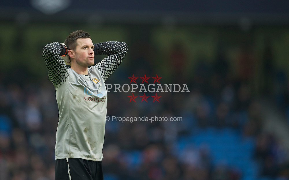 MANCHESTER, ENGLAND - Sunday, February 20, 2011: Notts County's goalkeeper Stuart Nelson looks dejected as his side are beaten 5-0 by Manchester City during the FA Cup 4th Round Replay match at the City of Manchester Stadium. (Photo by David Rawcliffe/Propaganda)