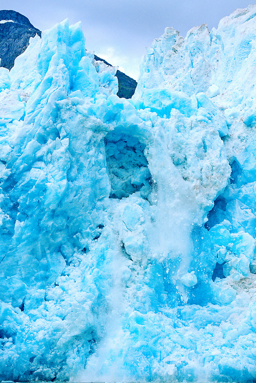 USA, Alaska, Tongass National Forest, Deep blue ice on vertical face of Le Conte Glacier on summer afternoon