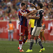 Robert Lewandowski, (left), FC Bayern Munich, protests after being fouled by Jair Pereira, Chivas,  during the FC Bayern Munich vs Chivas Guadalajara, Audi Football Summit match at Red Bull Arena, New Jersey, USA. 31st July 2014. Photo Tim Clayton