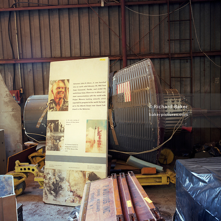 This is an unretouched scan made in August 2016 from a negative created in March 2000 on Merrit Island, Florida, USA. The picture shows a NASA space capsule once belonging to NASA space engineer Charles Bell whose collection of old space industry were auctioned after his death earlier that year. The capsule is seen here with other items to be sold, a day before the public auction. The copyright of this photograph belongs to Richard Baker (bakerpictures.com) who recorded the picture in person, on or around March, 3rd 2000. The scan was requested and paid for by Mark Calhoun in August 2016. It was ordered on the understanding that it is FOR PERSONAL USE AND INTERNAL REPRODUCTION ONLY. NO FURTHER REPRODUCTION WITHOUT PERMISSION FROM THE AUTHOR.