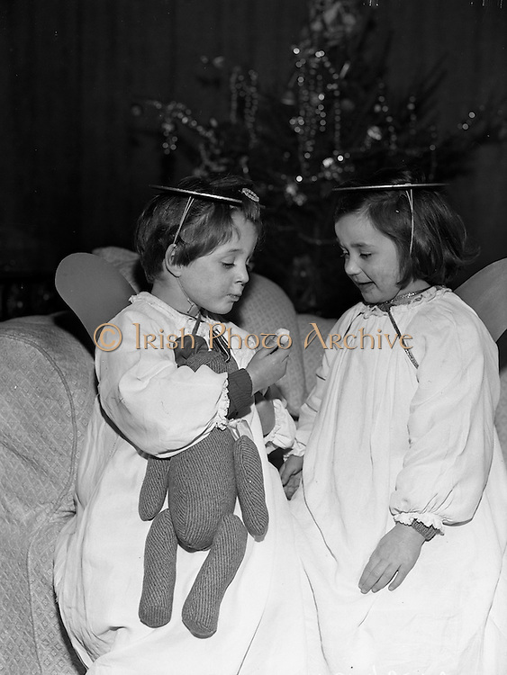 15/12/1960<br /> 12/15/1960<br /> 15 December 1960<br /> Carol singers at the Mansion House, Dublin, for Christmas. Children from St. Joseph's and St. Brigid's nurseries of the Civics Institute of Ireland sang Christmas carols for the Lord Mayor and helped him light the Christmas tree. Picture shows Noeleen Shelly and Patricia Donnelly enjoying some sweets given them by the Lord Mayor.