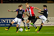 Jayden Stockley (11) of Exeter City takes on Glen Rea (16) of Luton Town and Alan Sheehan (44) of Luton Town during the EFL Sky Bet League 2 match between Exeter City and Luton Town at St James' Park, Exeter, England on 17 October 2017. Photo by Graham Hunt.