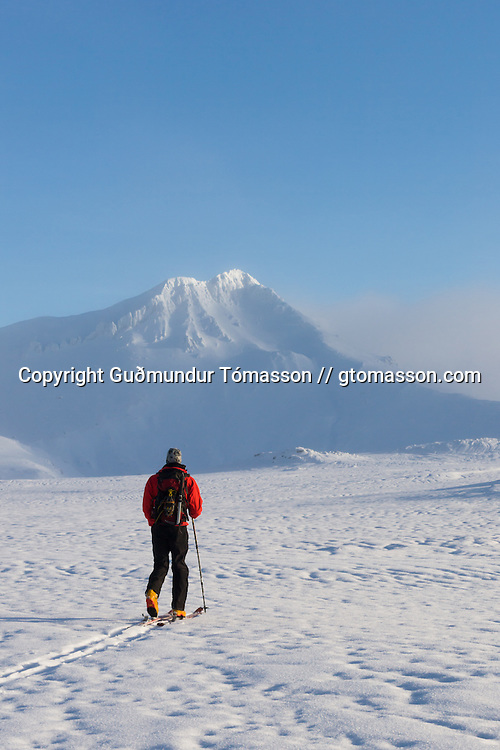 Arnar Felix Einarsson walking on skis towards mt. Hornklofi. Tindfjöll mountain range, Iceland.