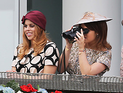 Princess's Beatrice and Eugenie in the Royal Box at the Epsom Derby in Epsom, England, Saturday 1st June 2013 Picture by Stephen Lock / i-Images
