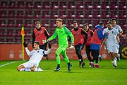 Dimitrios Nikolaou (#4) of Greece U21 slides on his knees to celebrate after scoring a penalty goal during the U21 UEFA EUROPEAN CHAMPIONSHIPS match between U21 Scotland and U21 Greece at Tynecastle Park, Edinburgh, Scotland on 15 November 2019.
