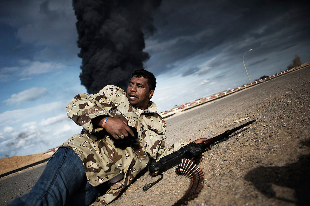 LIBYA, BIN JAWAD: Rebel during the fighting between anti and pro-Gadafy troupes, on March 11, 2011. ALESSIO ROMENZI