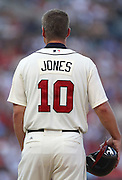 ATLANTA, GA - SEPTEMBER 01:  Third baseman Chipper Jones #10 of the Atlanta Braves stands on first base during a pitching change during the game against the Philadelphia Phillies at Turner Field on September 1, 2012 in Atlanta, Georgia.  (Photo by Mike Zarrilli/Getty Images)
