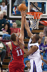 November 27, 2009; Sacramento, CA, USA;  Sacramento Kings forward Kenny Thomas (9) blocks a shot by New Jersey Nets center Brook Lopez (11) during the fourth quarter at the ARCO Arena. Sacramento defeated New Jersey 109-96.