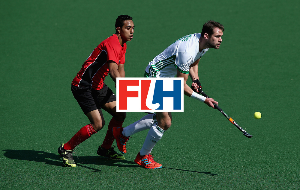 JOHANNESBURG, SOUTH AFRICA - JULY 13: Paul Gleghorne of Ireland and Mohamed Nasr of Egypt battle for possession during day 3 of the FIH Hockey World League Semi Finals Pool B match between Ireland and Egypt at Wits University on July 13, 2017 in Johannesburg, South Africa. (Photo by Jan Kruger/Getty Images for FIH)
