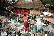 Mae Sot, Tak, Thailand - <br /> <br /> 'City Of Garbage' In Thailand<br /> <br /> A Burmese lady and her house at the Mae Sot garbage dump. Tingkaya also known as the City Of Garbage an area roughly the size of a football stadium The poor inhabitants make a living selling recyclable materials like wire, metal, glass, plastic. They heap dwellers survive by eating left-overs and sleep in the same harsh environment which is a breeding ground for bacteria and diseases.<br /> ©Exclusivepix