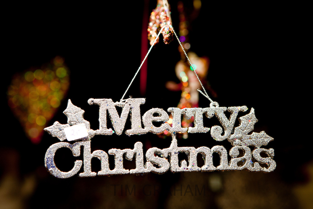 Merry Christmas sign on sale at Christmas market, Winter Wonderland, in Hyde Park, London