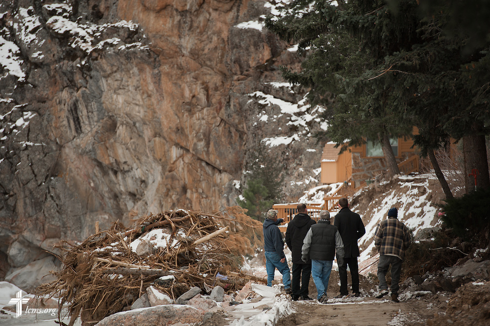 Richard McGurn (left, pointing) points out damage to property from September flooding near Estes Park, Colo., on Tuesday, Jan. 7, 2014. LCMS Communications/Erik M. Lunsford