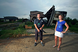 24 August 2006 - New Orleans - Louisiana. <br /> Lower 9th ward. Australian tourists and hurricane Katrina survivors Bud Hopes (33yrs - Brisbane) and Michelle Van Grinsven (22yrs- Sydney) return to the city almost a year after they were caught up in hurricane Katrina. Bud and Michelle were amongst the tourists evacuated to the Superdome during the storm. Bud emerged as the 'leader' of the tourist group of some 70 foreign tourists caught up in the hell that was the Superdome in the days after the storm last year. The two are shocked to discover the lack of action amidst the debris of the still ruined Lower 9th Ward.<br /> Photo; Charlie Varley/varleypix.com