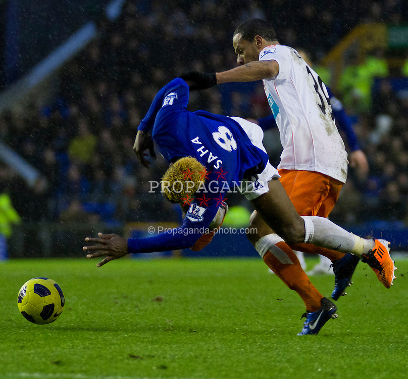 LIVERPOOL, ENGLAND - Saturday, February 5, 2011: Everton's Louis Saha and Blackpool's Dudley Campbell during the Premiership match at Goodison Park (Photo by Vegard Grott/Propaganda).