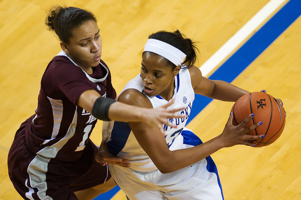 UK guard Bria Goss, right, drives around Mississippi State guard Candace Foster in the first half. The University of Kentucky Women hosted Mississippi State University Thursday, Jan. 17, 2013 at Memorial Coliseum in Lexington. Photo by Jonathan Palmer
