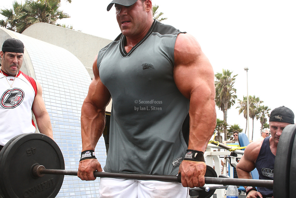 Mr. Olympia,  Jay Cutler doing bent over rows, working out in the pit at world famous Muscle Beach at Venice Beach California.