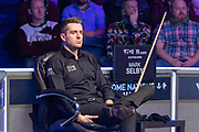 Mark Selby sits on his hands as he watches Jack Lisowski complete another break during first session of  the World Snooker 19.com Scottish  Open Final Mark Selby vs Jack Lisowski at the Emirates Arena, Glasgow, Scotland on 15 December 2019.
