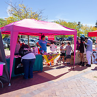 People visit the different information booths at the Gallup PRIDEfest Saturday at the McKinley County Courthouse Square.