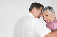 Couple embracing against white background portrait