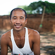 BAGAN, MYANMAR--A local artisan selling his paintings at Abeyadana Temple in Bagan. Located just south of Myinkaba Village in the Bagan Archeological Zone, Apeyadana Temple is named after Apeyadana, an 11th century chief queen consort of King Kyansittha of the Pagan Dynasty of Burma (Myanmar) and maternal grandmother of King Sithu I of Pagan. As with most Burmese names, it is transliterated into English in various ways. Other variations include Ape-ya-da-na, Ape-Yadana-Phaya, and Abeyadana.