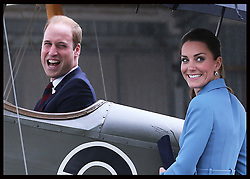 The Duke of Cambridge sits in the cockpit of a vintage aircraft watched by the Duchess of Cambridge  at the Omaka Aviation Heritage Centre in Blenheim, New Zealand, Thursday, 10th April 2014. Picture by Stephen Lock / i-Images