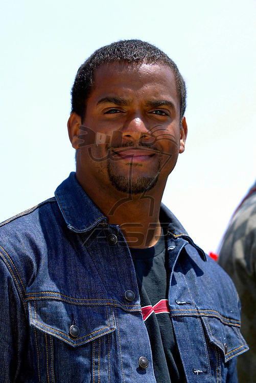 Alfonso Ribero smiles for the cameras during the Auto Club 500 NASCAR Winston Cup race at the California Speedway in Fontana, CA.