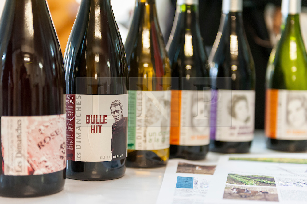 © Licensed to London News Pictures. 16/05/2016. London, UK. French wines with movie inspired labels.  Buyers and wine lovers visit the Raw Wine Fair at the Old Truman Brewery near Brick Lane.  The fair brings over 180 artisan growers and wine makers from around the world who specialise in producing organic, biodynamic and naturally made wines with minimal additives. Photo credit : Stephen Chung/LNP