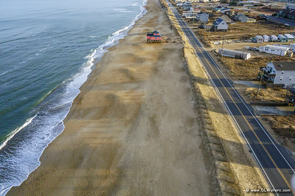 Aerial view of a lonely house on the beach at Kitty Hawk, NC.