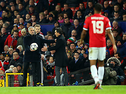 Manchester United manager Jose Mourinho hands the ball to Sevilla head coach Vincenzo Montella - Mandatory by-line: Robbie Stephenson/JMP - 13/03/2018 - FOOTBALL - Old Trafford - Manchester, England - Manchester United v Sevilla - UEFA Champions League Round of 16 2nd Leg