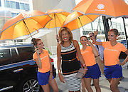IMAGE DISTRIBUTED FOR ACCUWEATHER -  Hoda Kotb is shaded from the hot summer sun by the AccuWeather MinuteCast street team at New York Fashion Week, on Tuesday, Sept. 15, 2015. The AccuWeather MinuteCast Street Team is at it again helping Fashion Week attendees stay stylish and one-step ahead of any possible precipitation. (Photo by Diane Bondareff/Invision for AccuWeather/AP Images)