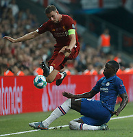 ISTANBUL, TURKEY - AUGUST 14: Jordan Henderson (L) of Liverpool and Kurt Zouma of Chelsea vie for the ball during the UEFA Super Cup match between Liverpool and Chelsea at Vodafone Park on August 14, 2019 in Istanbul, Turkey. (Photo by MB Media/Getty Images)