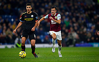 Football - 2019 / 2020 Premier League - Burnley vs. Manchester City<br /> <br /> Jack Cork of Burnley and Rodrigo of Manchester City at Turf Moor.<br /> <br /> COLORSPORT/LYNNE CAMERON