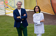 UNITED KINGDOM, London: 22 June 2015 Jose Selgas (L) and Lucia Cano (R) pose for a picture in front of the new Summer Serpentine Pavilion which they designed in London, England. Every year the Serpentine hosts a summer pavilion designed by famous architects. This years pavilion was designed by the duo who are a Madrid based firm called Selgascano.  Andrew Cowie / Story Picture Agency