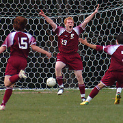 10 / 31 / 2006 -- BRUNSWICK, Maine. Bangor Senior Troy Jellison, center, celebrates after scoring the first Bangor goal. Brunswick boys fell in double overtime 2-1 to Bangor in the Eastern Maine Boy's Championship game held on Halloween. Photo by Roger S. Duncan.
