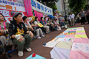 Sachiko Saito (left) organiser of the Fukushima Mother's protest outside METI (Ministry of Economy, Trade and Industry) in Tokyo, Japan. Friday June 29th 2012. About 400 protesters campaigned the restarting of the Oi nuclear power-station and the policy of Prime-Minister Noda to restart Japan's nuclear power generation programme which has been stalled since the earthquake and tsunami of March 11th 2011 caused meltdown and radiation leaks at the Fukushima Daichi Nuclear power-plant.