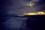 landscape photography: coastline along Great Ocean Road Victoria, showing stormy clouds at sunset