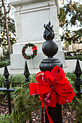 Christmas bows decorate ironwork in Pulaski Square in Savannah, GA.