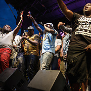 WASHINGTON, DC - August 17th, 2013 -  Wale (center) performs at the 2013 Trillectro Festival at the Half Street Fairgrounds in Washington, D.C.  Citing contractual restrictions from an upcoming tour with J. Cole, his brief performance consisted of hooks and choruses, but no complete songs. (Photo by Kyle Gustafson / For The Washington Post)