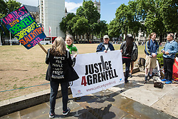 London, UK. 6 June, 2019. Campaigners from Justice4Grenfell and housing groups including Defend Council Housing protest outside Parliament during a debate on Grenfell almost two years after the Grenfell Tower fire in North Kensington on 14th June 2017 during which 72 people died and over 70 were injured. Other campaigners were in the public gallery for the debate.