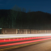 Car lights illuminate a stationary coal train near the Mammoth Coal Processing Plant. Kanawha Valley, West Virginia.