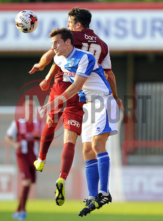 Bristol Rovers' Tom Lockyer battles for the high ball with Cheltenham Town's Terry Gornell - Photo mandatory by-line: Joe Meredith/JMP - Mobile: 07966 386802 15/07/2014 - SPORT - FOOTBALL - Bristol - Whaddon Road - Cheltenham Town v  Bristol Rovers