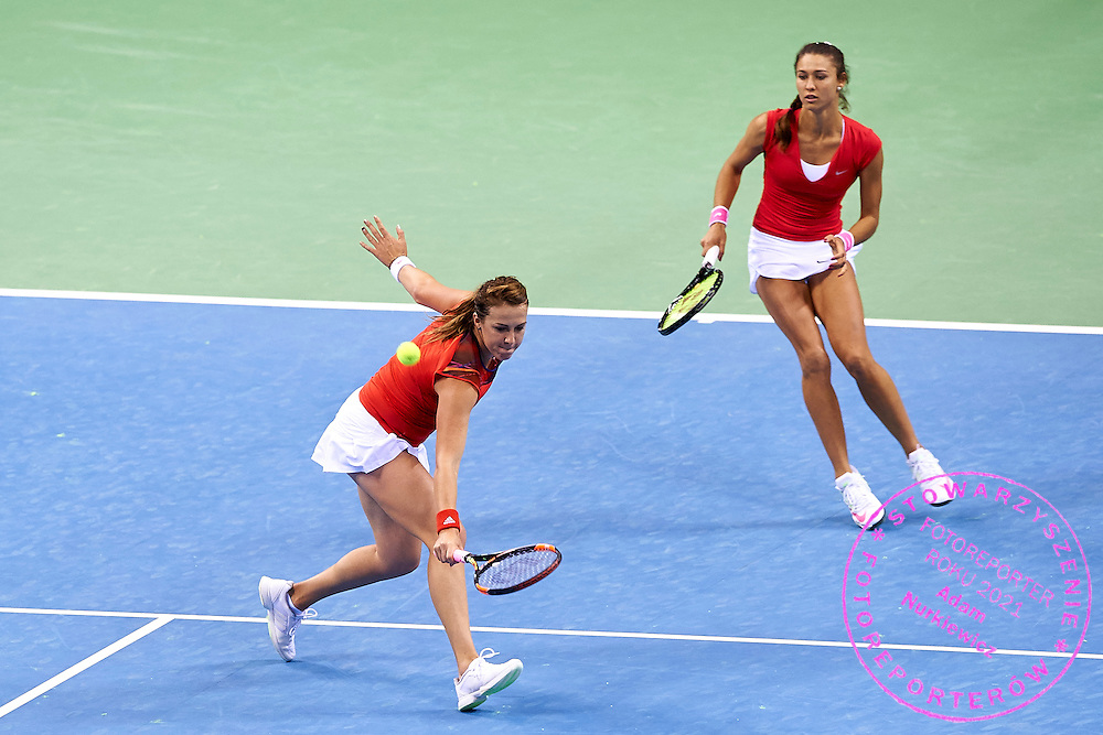 (L) Anastasia Pavyuchenkova and (R) Vitalia Diatchenko both from Russia in action during Second Day of the Fed Cup / World Group 1st round tennis match between Poland and Russia at Tauron Krakow Arena on February 8, 2015 in Cracow, Poland.<br /> <br /> Poland, Cracow, February 8, 2015<br /> <br /> Picture also available in RAW (NEF) or TIFF format on special request.<br /> <br /> For editorial use only. Any commercial or promotional use requires permission.<br /> <br /> Adam Nurkiewicz declares that he has no rights to the image of people at the photographs of his authorship.<br /> <br /> Mandatory credit:<br /> Photo by &copy; Adam Nurkiewicz / Mediasport