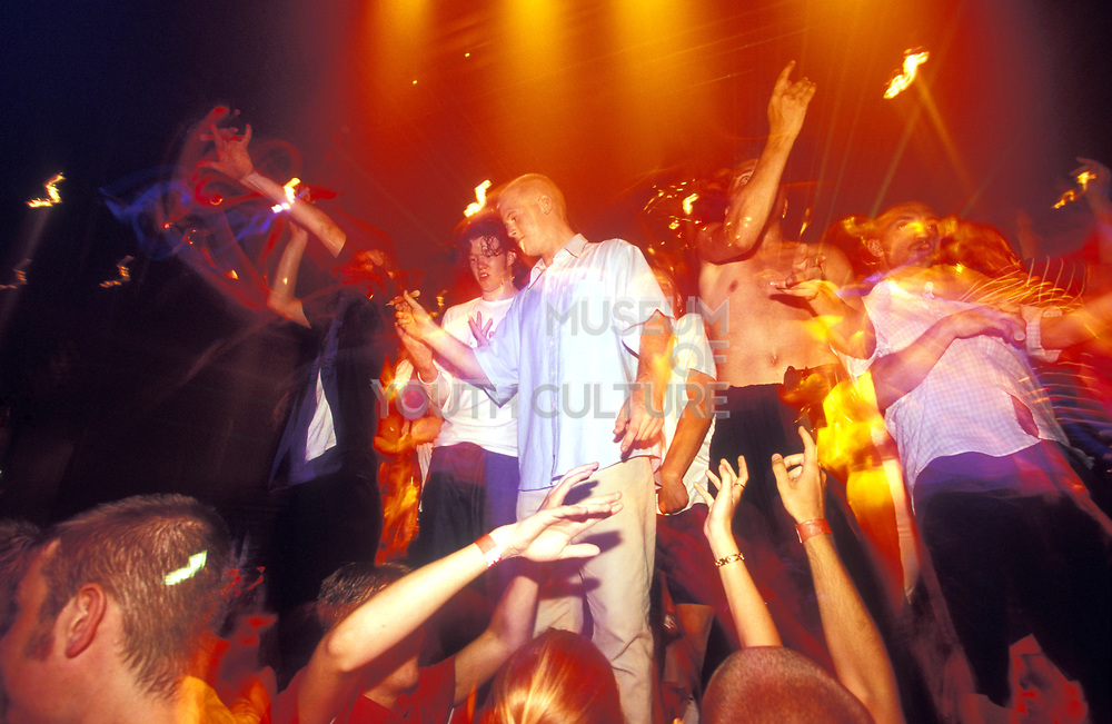 clubbers dancing up on stage, UK 2000's