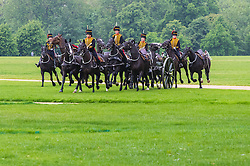 Hyde Park, London, June 2nd 2016. Soldiers and guns of the King's Troop Royal Horse Artillery fire a 41 round Royal Salute to mark the 63rd anniversary of the coronation of Britain's Monarch HM Queen Elizabeth II. PICTURED: The horses charge across the field to collect the guns following the salute.