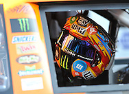 Fox Sports -- The helmet of NASCAR Sprint Cup Series driver Kyle Busch (18) hangs inside the car before the Hollywood Casino 400 at the Kansas Speedway.