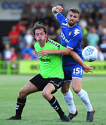 Theo Archibald of Forest Green Rovers competes with Stuart Dallas of Leeds United- Mandatory by-line: Nizaam Jones/JMP- 17/07/2018 - FOOTBALL - New Lawn Stadium - Nailsworth, England - Forest Green Rovers v Leeds United - Pre-season friendly