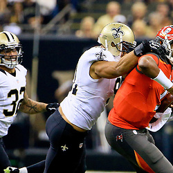 Sep 20, 2015; New Orleans, LA, USA; New Orleans Saints outside linebacker Kasim Edebali (91) sacks Tampa Bay Buccaneers quarterback Jameis Winston (3) during the first quarter of a game at the Mercedes-Benz Superdome. Mandatory Credit: Derick E. Hingle-USA TODAY Sports